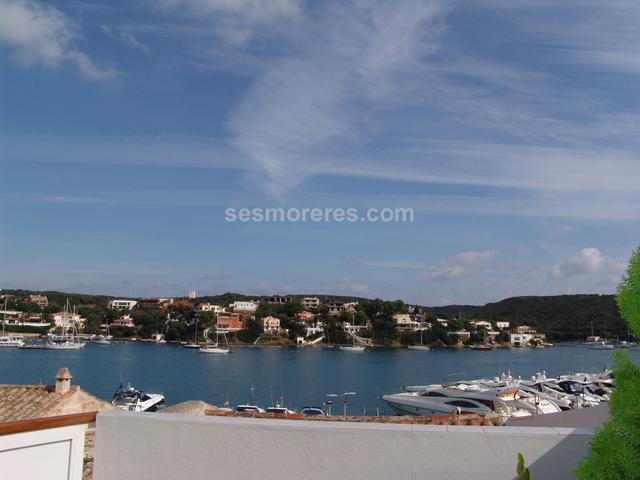 Duplex apartment having a large terrace with fantastic views of the port of Mahon, finished to a high quality and with a loft area which would be ideal as a studio or office. Built surface area of 172 m²,  3 double bedrooms,  2 bathrooms, kitchen, terrace, storage room, marble floors, garage, built-in wardrobes, double glazing, ducted air-conditioning (with reverse cylcle heat pump), sea view, front line.