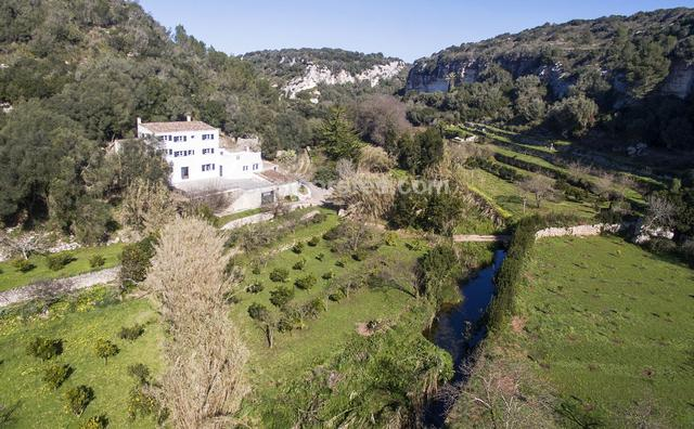 Idyllic country estate of 200.000m² located in the emblematic Algendar Gorge Nature Reserve of Menorca and renowned for its scenic beauty. It has a main house on two floors of approx. 370 m² built area, and also stables and other smaller constructions. From the property you can walk down to the beach at Cala Galdana. The soil on the property is arable and is very fertile and the property has its own well. The place is unique and full of magic and charm everywhere you look. Energy certif. (E) 164 Kwh/m²a.