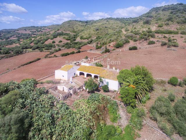Large country estate of 137 hectares with 360º sea views, and on which stands a very old architectural group of buildings of more than 1000m² built area; composed of a main house and different agricultural constructions that keep intact their original design and character.