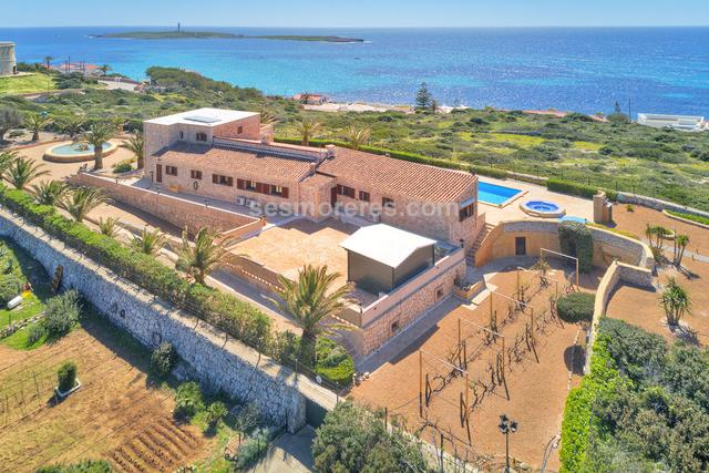 A spectacular property in a unique location.  The villa is orientated to maximize the stunning sea views which can be enjoyed from most of the house, and especially from the spacious main bedroom and terrace which occupy all the first floor.  It has been built to a high standard and perfectly maintained.  The elegant ground floor consists of various zones with a study area, kitchen, lounge and dining area with doors leading to the covered terraces beside the pool and jacuzzi.  A lift provides access to the extensive garage with wine cellar.  The  surrounding gardens provide a sauna, vineyard, fountain, vegetable garden etc. Built surface 574 m², 35000 m² plot,  4 bedrooms (3 double,  1 single),  4 bathrooms, kitchen, laundry, dining room, terrace, garden, garage, furnished, construction year, sunny, patio, balcony, sea view, State certification: .