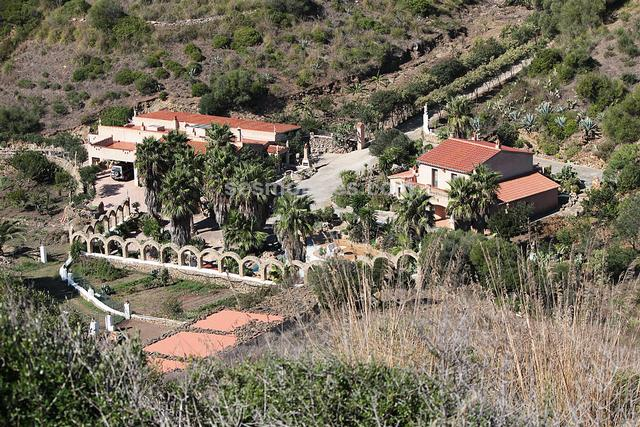 Country property located in an idyllic valley near the town of Ferrerias.  There are two houses divided into 5 apartments, with stables and other small agricultural constructions, it has a large swimming pool with two waterfalls, that form a total built area of 630m² on land of 31 hectares.  It has a well, and electricity is provided by means of photovoltaic panels, a wind turbine, and a generator.
