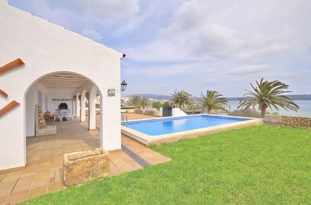 Impressive villa located on the seafront in the exclusive area of Fornells. Its elevated position allows you to enjoy beautiful views over the port and all the natural environment of the bay of Fornells. The house is distributed on 2 floors with large and bright spaces. The 3 double bedrooms are on the first floor and have a large terrace, overlooking the sea. You enter the house through a large hall with vaulted ceilings. On the same floor there is another bedroom, the kitchen with dining area and the living room with fireplace with access to the porch with barbecue in front of the house. The water sports area of Ses Salines is within walking distance and the fishing village and traditional centre of Fornells is just a few minutes walk away.
