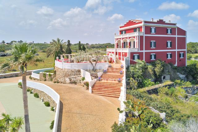A beautiful and dignified colonial style property that clearly defines its historical connections. The main house has been completely modernized to a high standard, providing the maximum comfort as an inviting and charming rural hotel. It consists of a total of 11 bedrooms and bathrooms including accommodation in the nearby cottages. Sea views can be enjoyed from the terraces and several of the bedrooms, whilst the large terrace of the pool area is quiet and relaxing. A second house located in the surrounding grounds and attractive gardens provides an additional 4 double bedrooms. It is well situation for the amenities of the local town of Es Castell. Built surface area 1677 m².