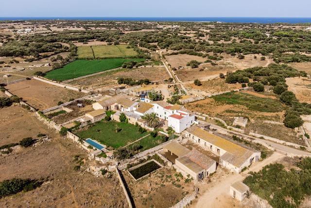 This old Menorcan farmhouse lies south of the beautiful town of Ciutadella. It is in the countryside surrounded by farms, but only a short drive through the vineyards from local beaches.  The house has a tourist licence for letting, and visitors will be delighted by the ancient vaulted ceilings and the charming courtyard, but it is also ideal for a home to be enjoyed all year.  There are presently four double bedrooms with the option of converting up to three more rooms for additional accommodation, some renovation work will be required. There is the possibility of buying the adjoining farm as well. 360000 m² plot size, cultivable, well, electricity.