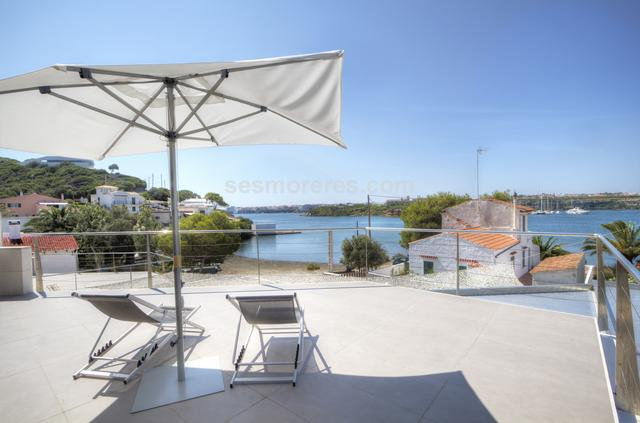Incomparable newly built villa situated on the waterfront in the Port of Mahon. The property occupies a privileged position just above the beach in Cala Partió. The property is built with materials and finishes of the highest quality and enjoys the sea views from almost any point of the house. It also has a large garage with capacity for boat storage. Built surface 220 m², 500 m² plot,  4 bedrooms (4 double),  3 bathrooms, kitchen, terrace, garden, garage, built-in wardrobes, heating, double glazing, construction year (2014), air conditioning, sunny, swimming pool, front line, sea view, Storage room.