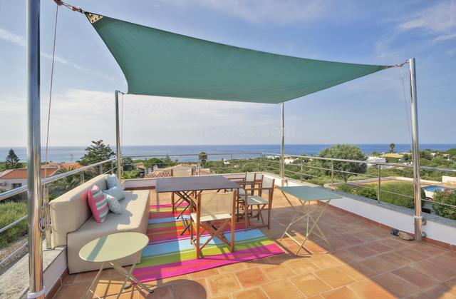 A stunning recently-built contemporary villa with amazing views over the south coast of the island. This villa of 247m² is finished with high-quality finishes on a plot of 1002m² in one of the most exclusive parts of Binibeca. On the ground floor the entrance hall leads through to a spacious living/dining room, a separate kitchen with utility room, and cloakroom, and the living areas lead to large terraces and the swimming pool with amazing sea views On the lower floor there are 4 double bedrooms with fitted wardrobes and three bathrooms.  There are also two large storage rooms.  Outside, an external staircase leads to the spectacular roof terrace with barbecue, dining and chill-out area and with amazing views over the south coast. There is a car port with an off-road parking space.  The property has air conditioning with heat pump throughout the house and so the property is perfect for all-year-round living.  Engergy Efficiency (E).